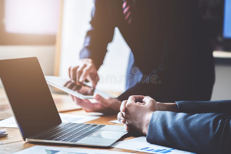 Business team present. Young business people have meeting and working in modern office. Laptop, tablet and documents on a working stock photos
