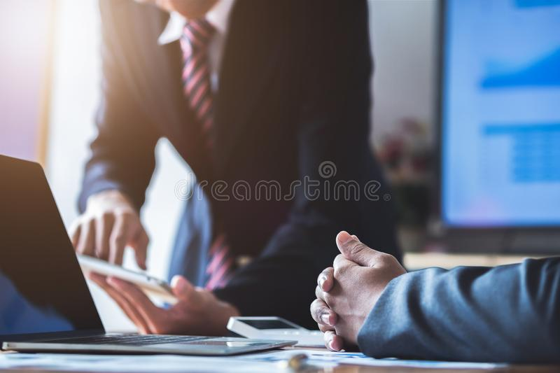 Business team present. Young business people have meeting and working in modern office. Laptop, tablet and documents on a working royalty free stock images