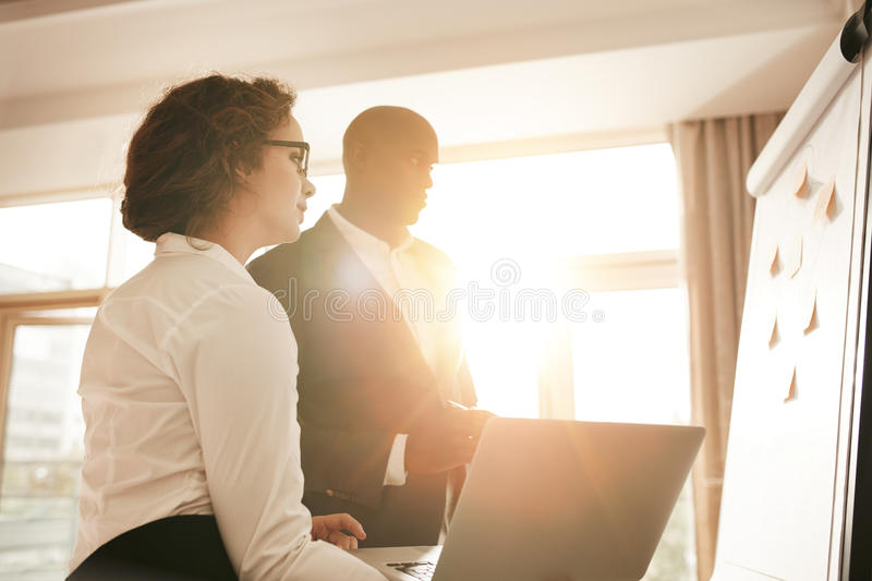 Business team during a presentation at the conference room royalty free stock images