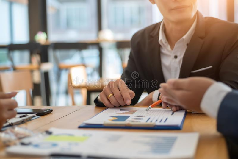 Business team professionals working analyzing data with financial report in the office. Accounting concept. Business team professionals working analyzing data stock photography