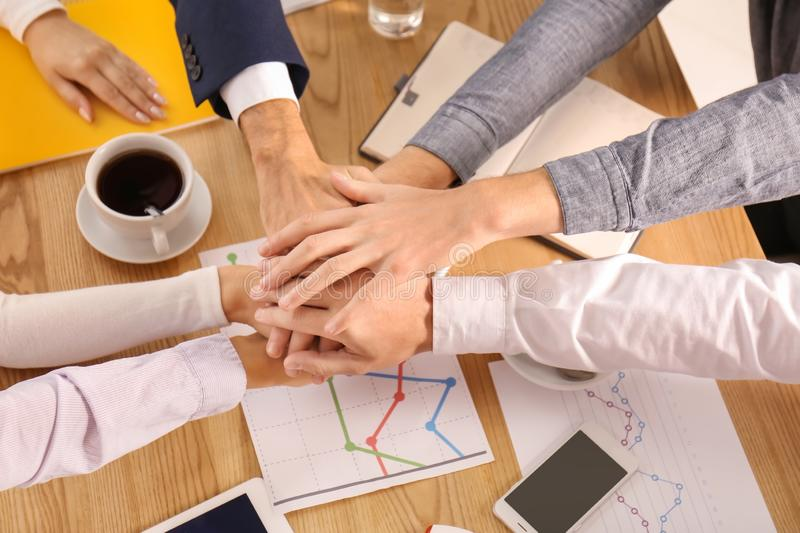 Business team putting hands together as symbol of unity royalty free stock image