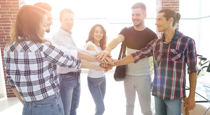 Business Team putting their hands together. Celebration unity and teamwork stock photos