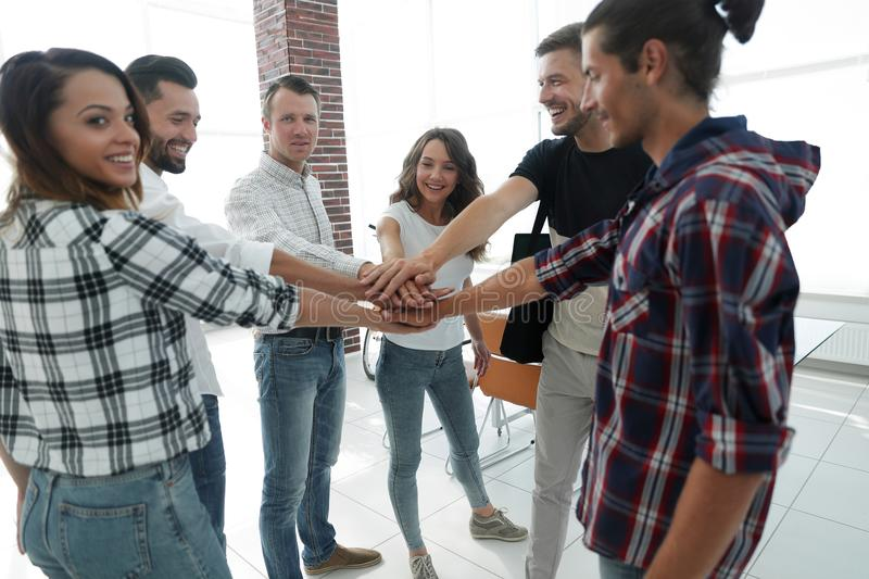 Business Team putting their hands together. Celebration unity and teamwork royalty free stock images
