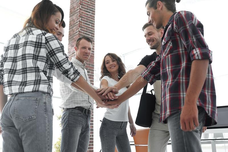 Business Team putting their hands together. Celebration unity and teamwork royalty free stock image