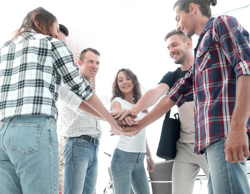 Business Team putting their hands together. Celebration unity and teamwork stock image