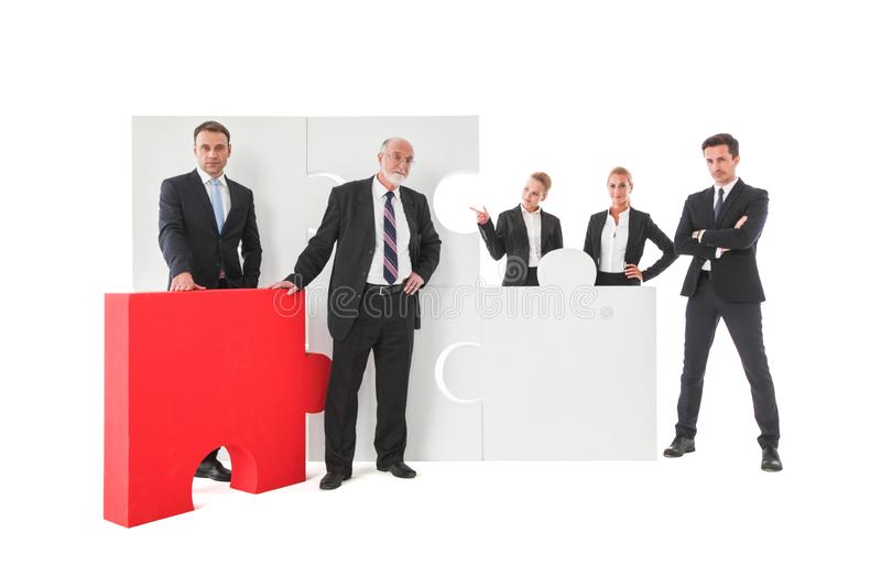 Business team and puzzle elements royalty free stock image