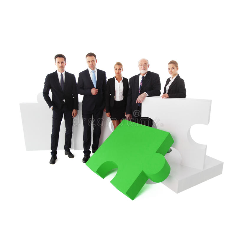 Business team and puzzle royalty free stock image