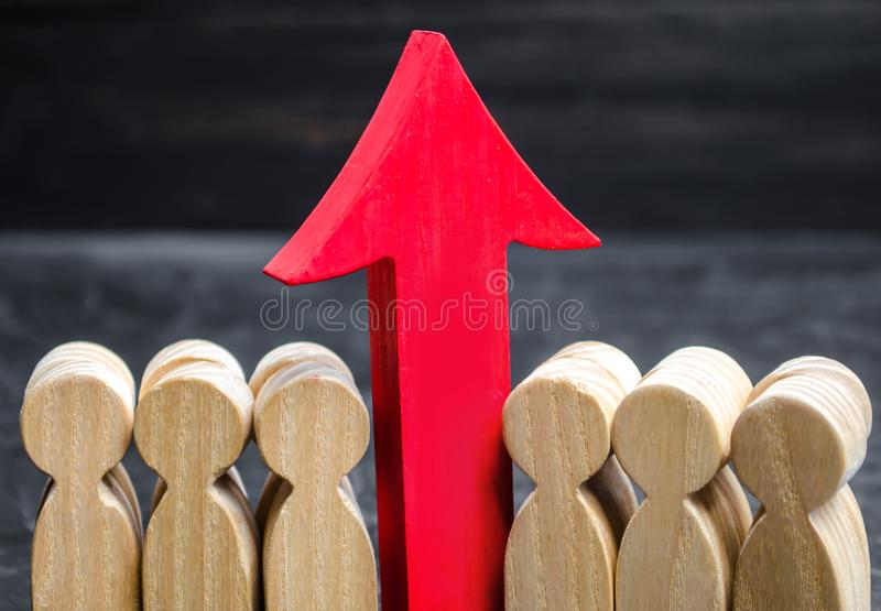 Business team and red up arrow between employees. The concept of a startup. Successful business growth. Qualification and. Retraining of workers. Starting a new royalty free stock image