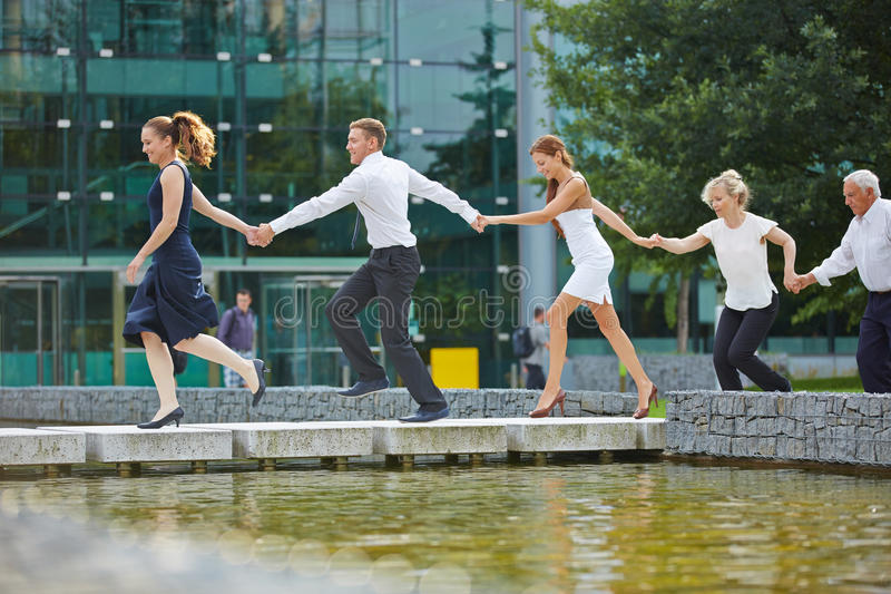 Business team running with holding hands stock image