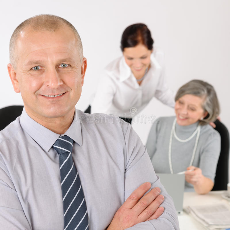 Business team senior manager with happy colleagues royalty free stock photography