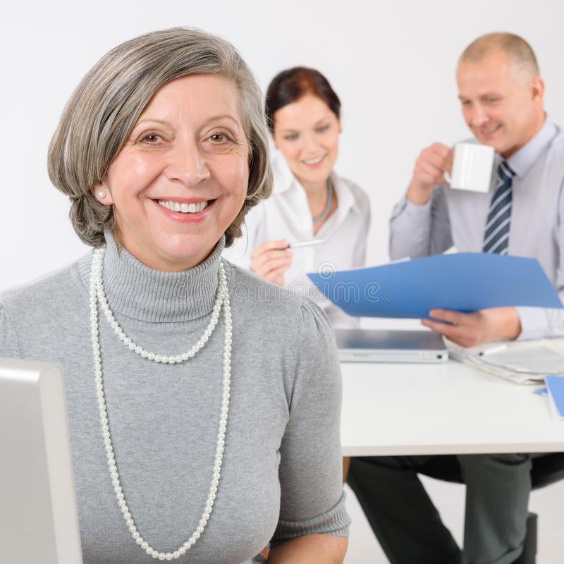 Business team senior manager woman with colleagues royalty free stock image