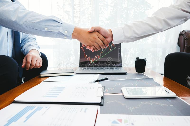 Business Team shaking hands with Investment Entrepreneur Trading discussing and analysis graph stock market trading,stock chart stock photo