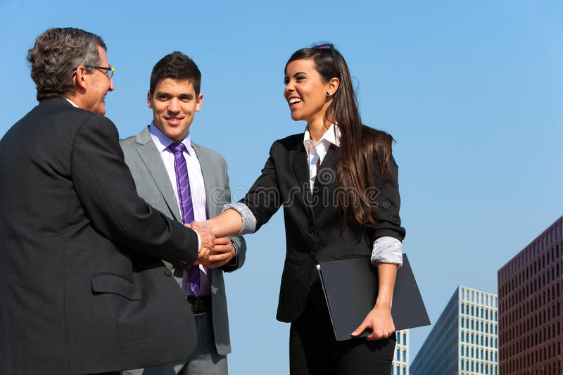 Download Business Team Shaking Hands Over Deal Outdoors. Stock Image - Image: 24835219