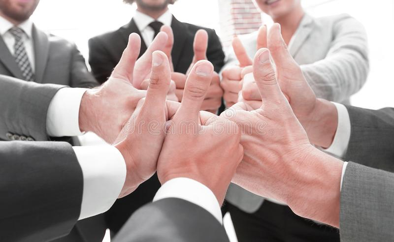 Business team showing thumbs up. Closeup. business team showing thumbs up.success concept royalty free stock image