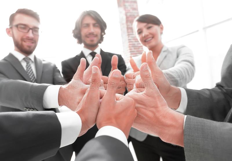 Business team showing thumbs up. Closeup. business team showing thumbs up.success concept royalty free stock photography