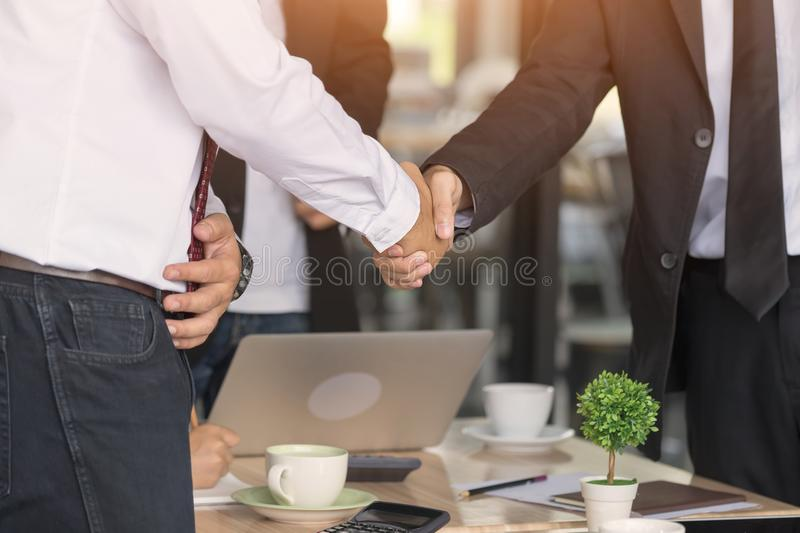 Business team are showing unity with their handshake together. stock photo