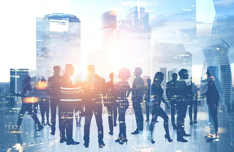 Business team silhouettes in Moscow city stock images