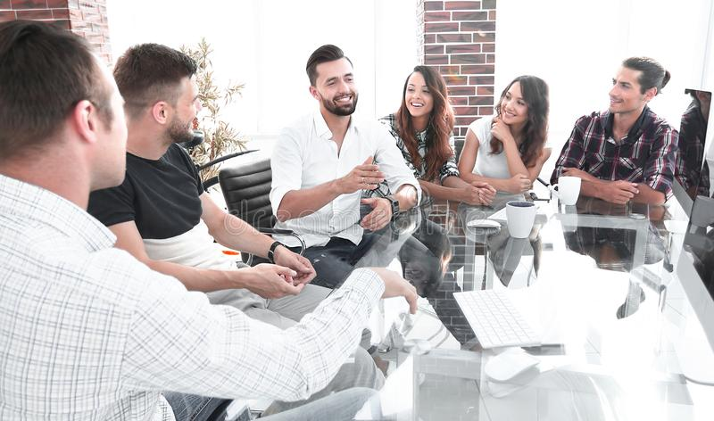 Business team sitting at a modern Desk. royalty free stock photography