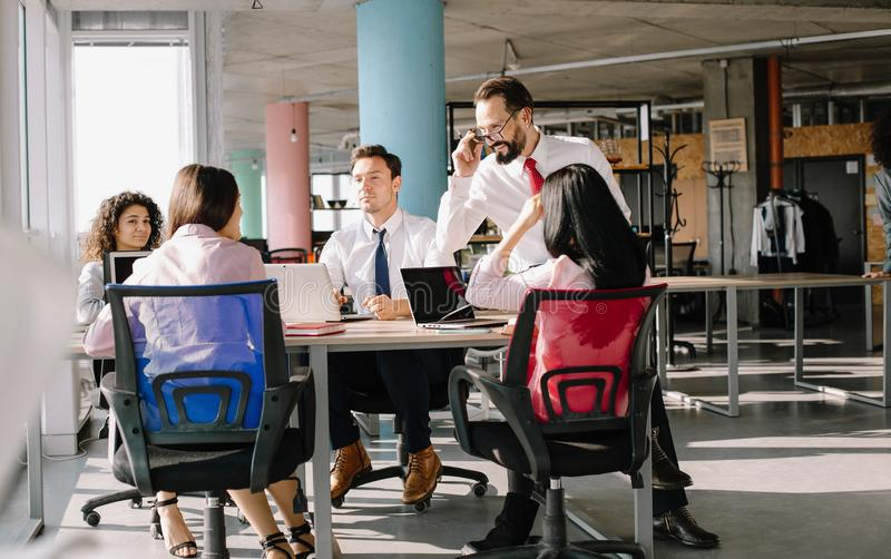 Creating of new important project. Business team sitting in modern office.Taking decision about new project royalty free stock image