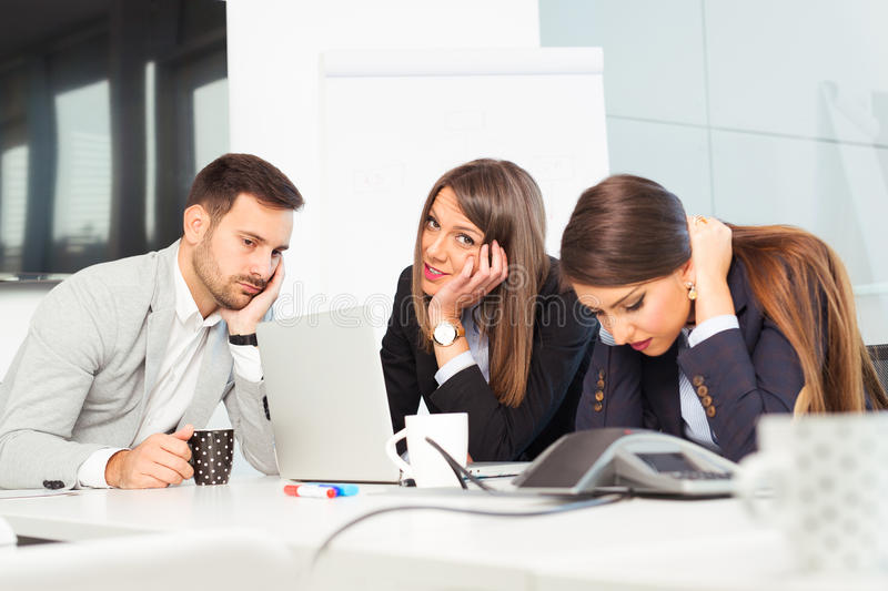 Business team sitting sad and solving problem in office royalty free stock images