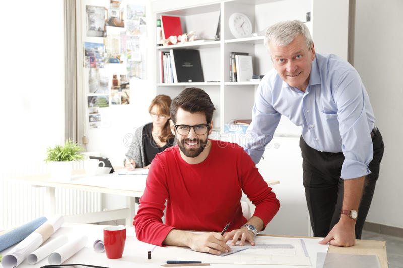 Business team in small architect studio. Business team working together in small architect studio stock images