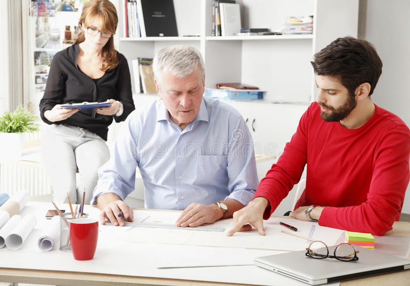 Business team in small architect studio. Business team working together in small architect studio stock photography