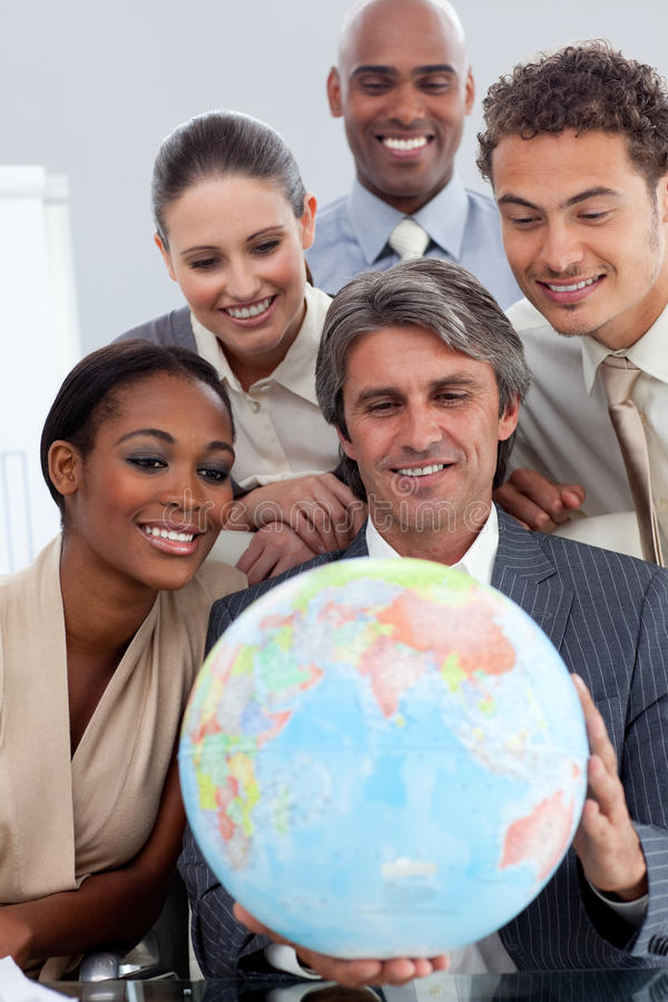 Business team smiling at global business expansion