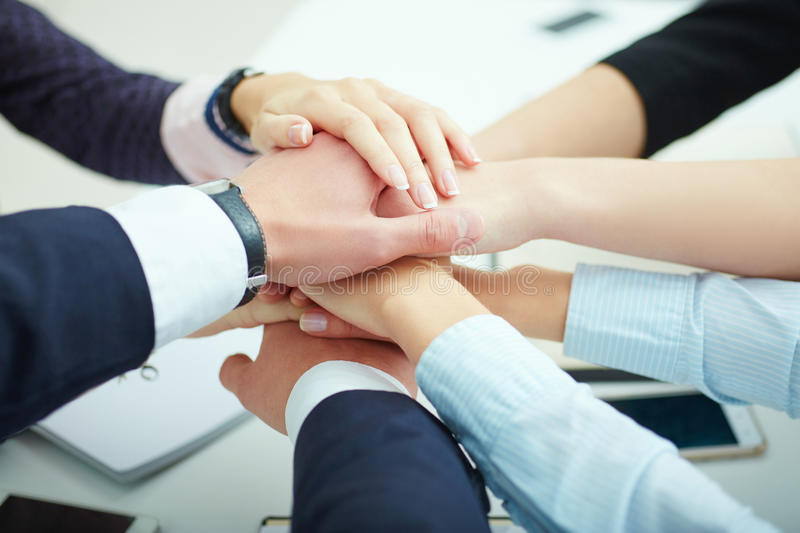 Business team stack hands support concept. Network connection with many hands of a business team from above stock photography