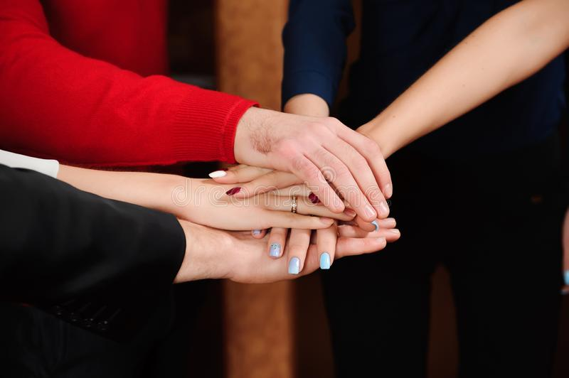Business Team Stack Hands Support Concept, people in office holding a conference and discussing strategies. Business Team Stack Hands Support Concept royalty free stock photo