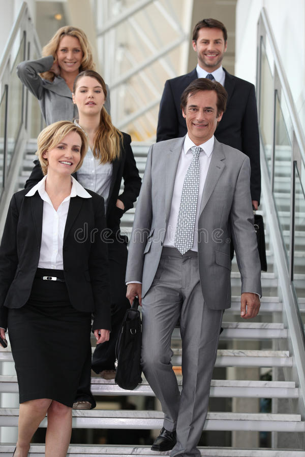 Business team in stairs. Portrait of a business team in stairs royalty free stock photo