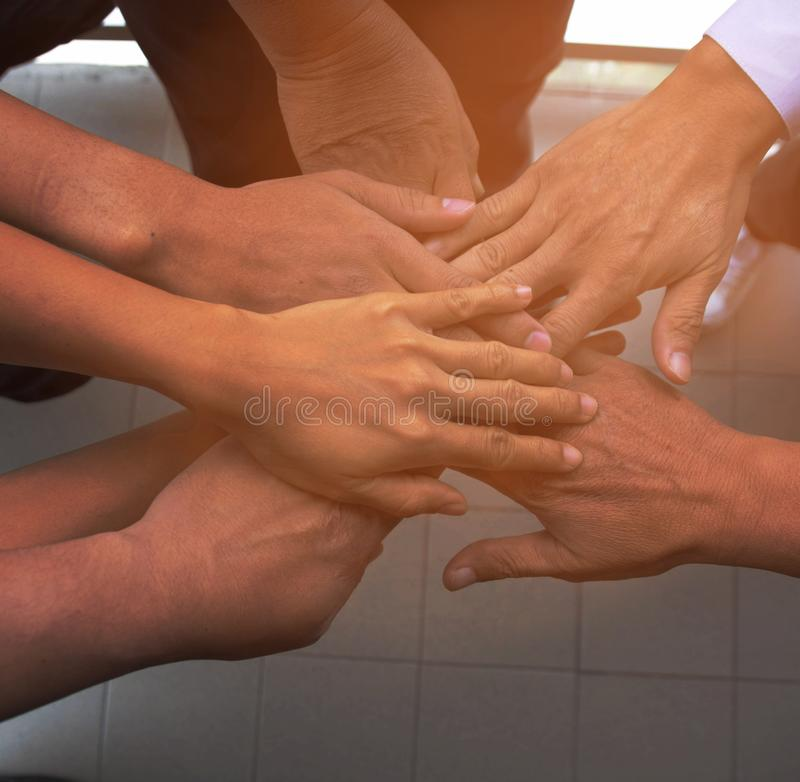 Business team standing hands together people joining for cooperation success business. Teamwork concept royalty free stock photos