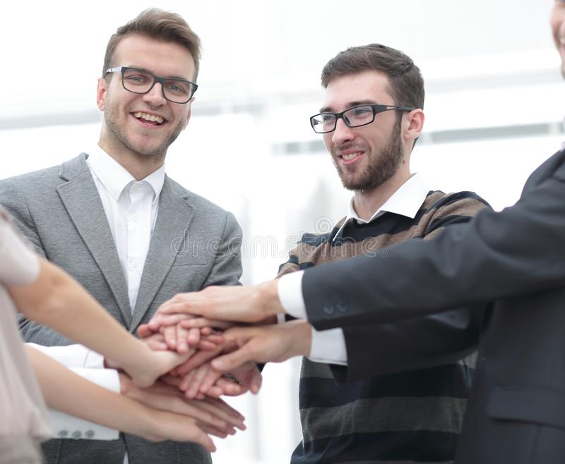 Business team standing joining hands together stock photos