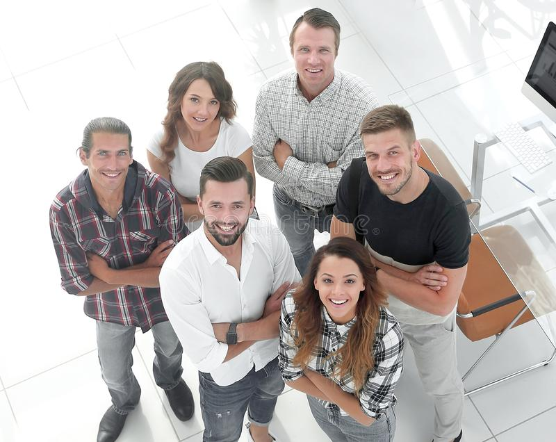 Business team standing near the desktop royalty free stock photography