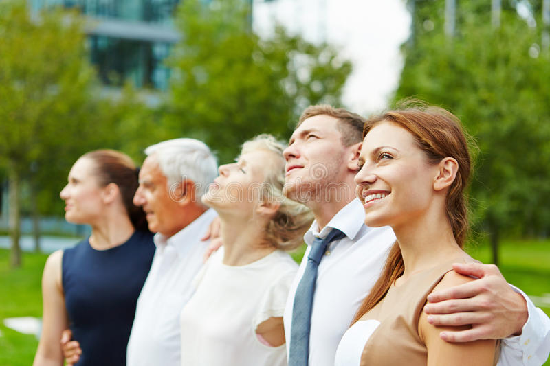 Business team standing in a row stock photography