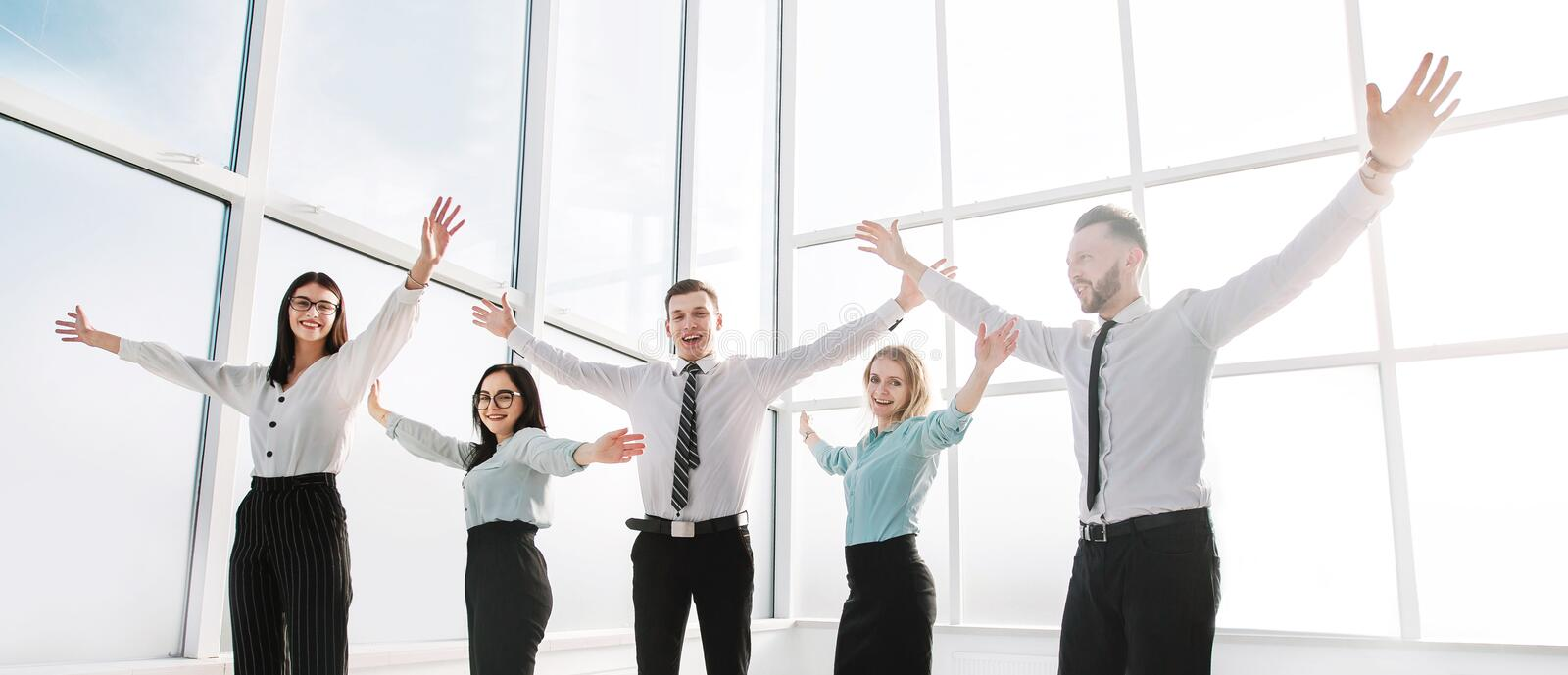 Business team standing in spacious new office. royalty free stock images