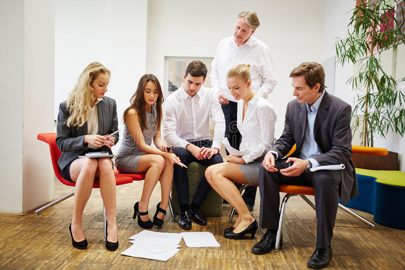 Business team during a strategy meeting. Group of business people as a team during a strategy meeting stock images