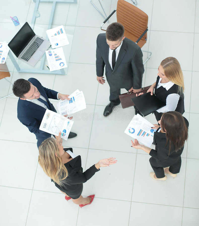 Business team studying and discussing documents. High view stock images
