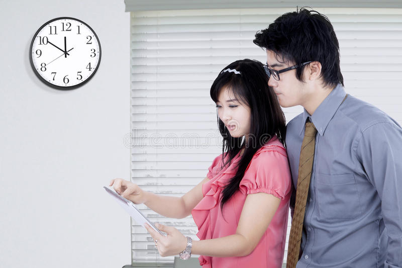 Business team with tablet and clock stock photos