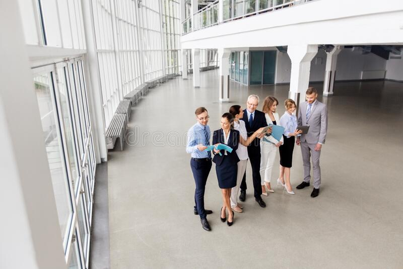 Business team with tablet pc and folders at office royalty free stock photo
