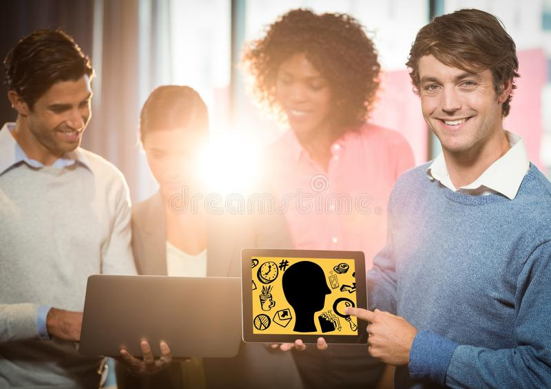 Business team with tablet showing head doodle against yellow background royalty free illustration