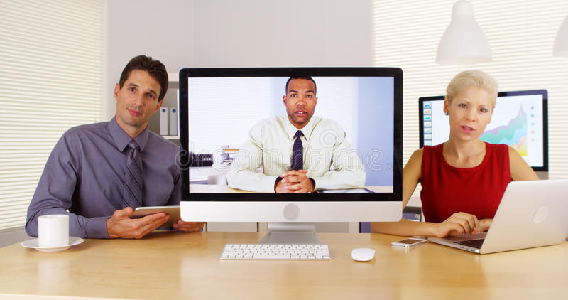 Business team talking and listening to camera royalty free stock photography