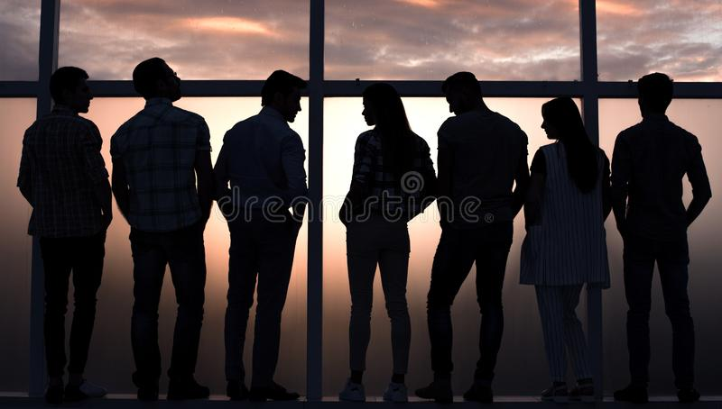 Business team talking standing near a large window stock photos