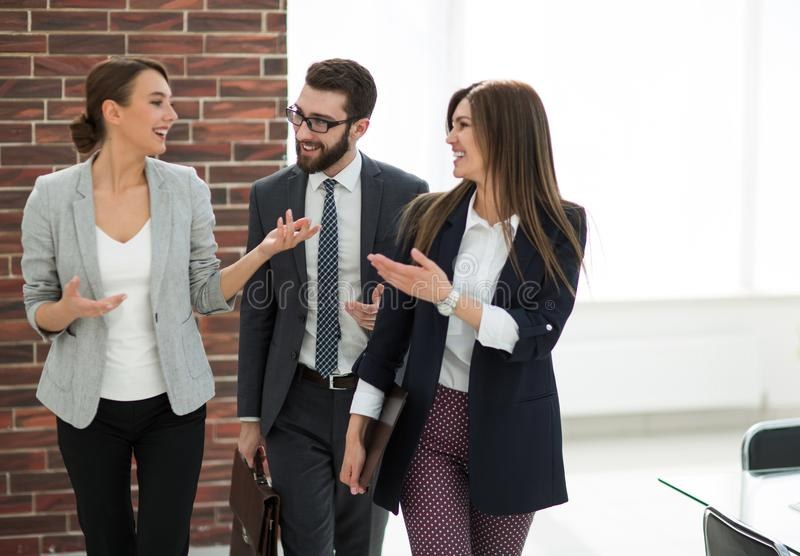 Business team talking standing in the office stock photo