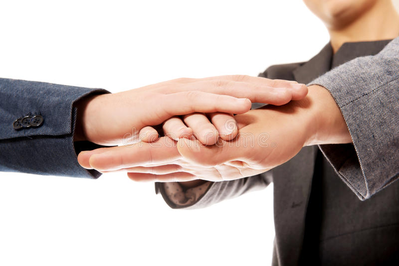Business team with their hands together stock images