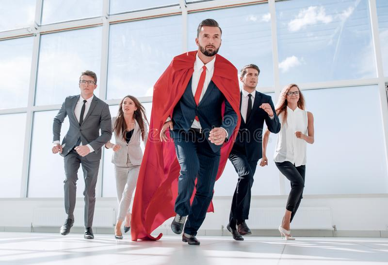 Business team and their leader are marching in the office lobby. Photo with copy space royalty free stock image