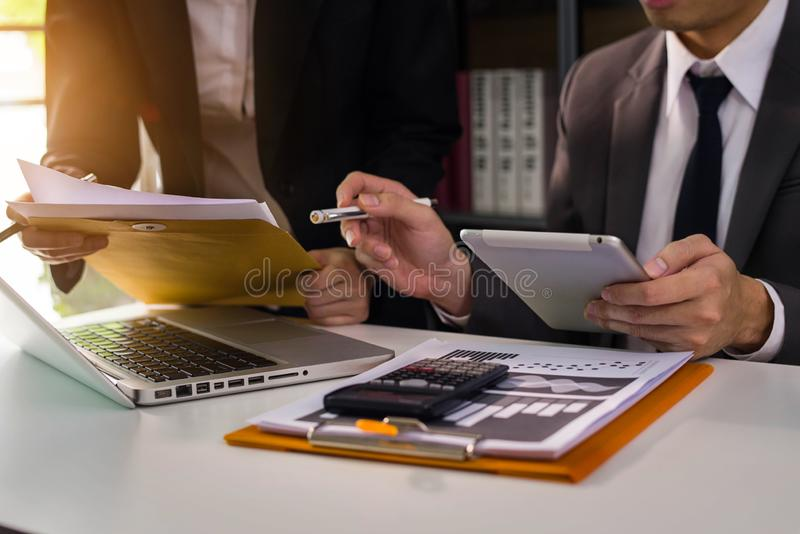 Business team to calculate financial information. Business team to calculate financial information to invest in new projects. financial manager meeting.euing stock photo