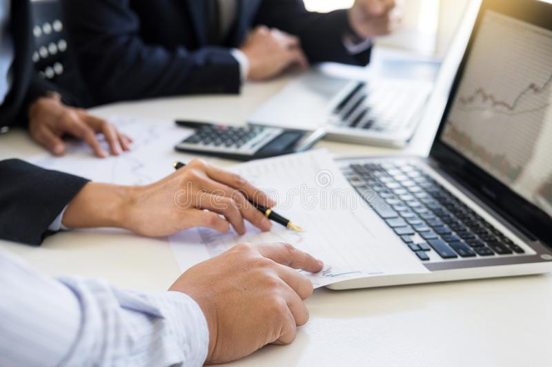 Business Team trader or broker Investment Entrepreneur colleagues working discussing and analysis graph stock market trading with. Forex chart data financial royalty free stock images