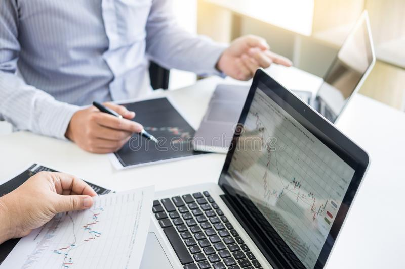 Business Team trader or broker Investment Entrepreneur colleagues working discussing and analysis graph stock market trading with. Forex chart data, financial stock photography