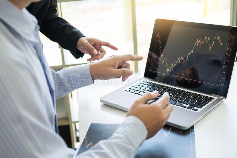Business Team trader or broker Investment Entrepreneur colleagues working discussing and analysis graph stock market trading with. Forex chart data, financial royalty free stock photo