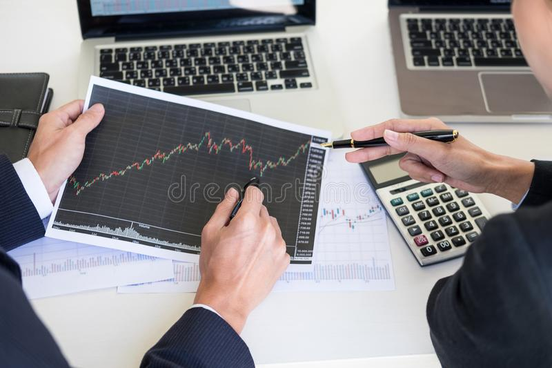Business Team trader or broker Investment Entrepreneur colleagues working discussing and analysis graph stock market trading with. Forex chart data, financial royalty free stock image